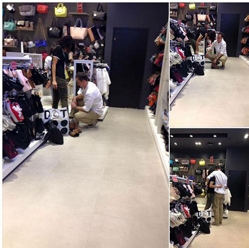 Tranh cãi hình ảnh người đàn ông cúi xuống thử giày cho bạn gái