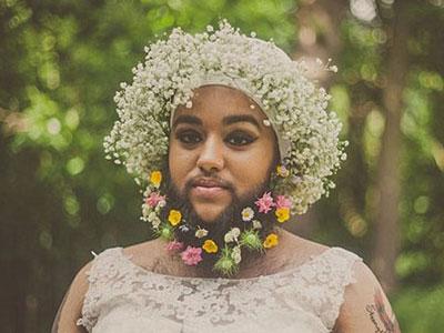 Cô gái có râu e ấp trong váy cưới
