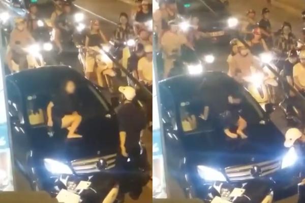 Vì ghen tuông, cô gái trẻ gào khóc trèo lên nắp capô đập kính xe Mercedes giữa phố Hà Nội? - Ảnh 2.