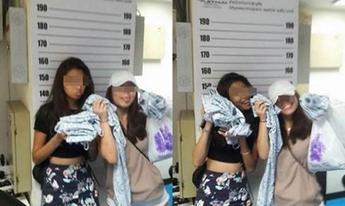 Bị bắt vì trộm cắp, thiếu nữ Singapore vẫn tươi cười chụp ảnh - ảnh 1