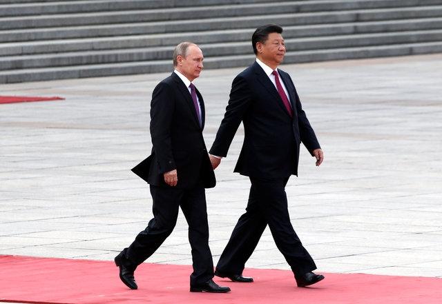 Tổng thống Nga Vladimir Putin và Chủ tịch Trung Quốc Tập Cận Bình tại Bắc Kinh ngày 25/6 (Ảnh: AFP)