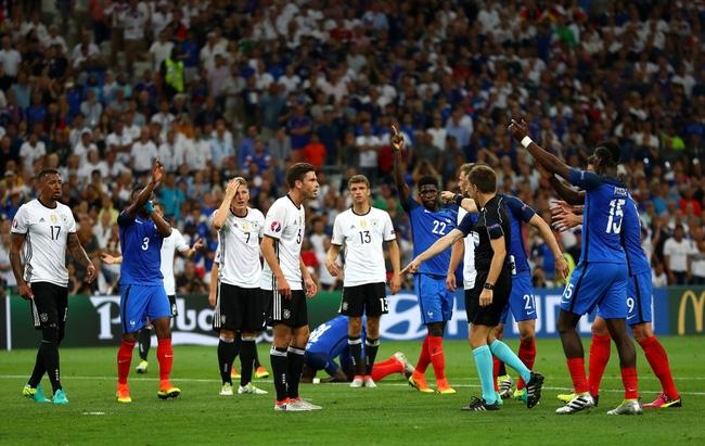 Trọng tài Rizzoli bị tố thổi phạt đền Đức để trả thù cho Italia - Ảnh 3.