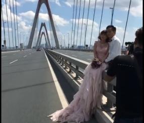 Cặp đôi chụp ảnh cưới giữa cầu Nhật Tân gây tranh cãi - Ảnh 4