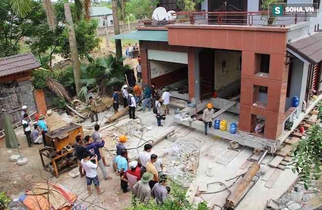 Quá trình di chuyển căn nhà nặng 800 tấn lùi xa 35m ở Nghệ An - Ảnh 5.