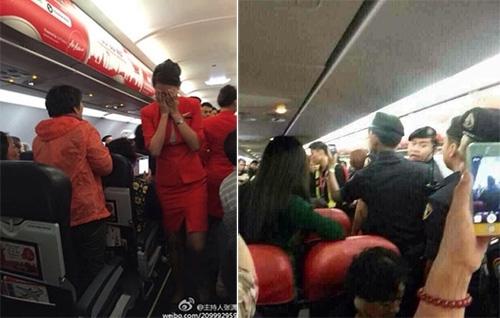 Máy bay buộc phải quay đầu vì hành khách Trung Quốc hất nước nóng vào tiếp viên hàng không - Ảnh 1.