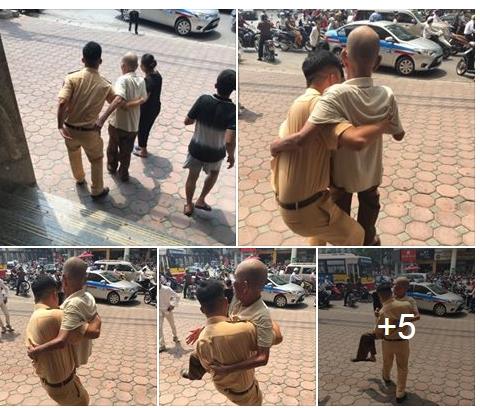 Cảm kích hành động đẹp của chiến sĩ CSGT với cụ ông trên phố Hà Nội - Ảnh 1