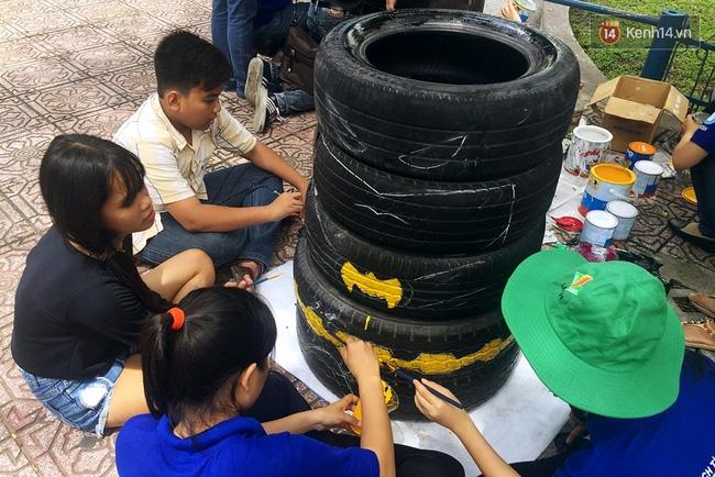 Những siêu anh hùng làm bằng lốp xe cũ vô cùng đáng yêu trên đường phố Sài Gòn - Ảnh 6.