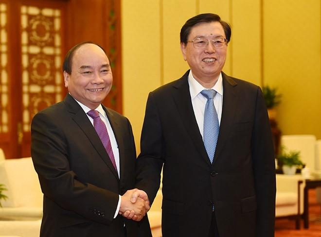 Thu tuong Nguyen Xuan Phuc hoi dam voi Thu tuong Trung Quoc hinh anh 2