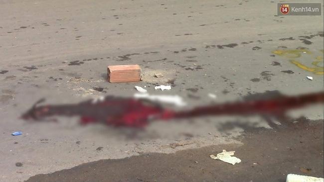 Bình Dương: Tránh vũng nước, cô gái trẻ bị xe container cán chết thảm - Ảnh 2.