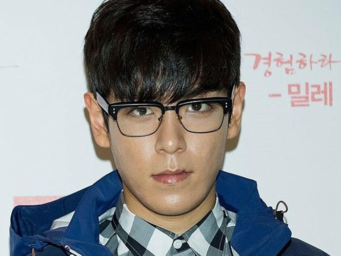 TOP không thể tiếp tục chịu đựng sự quấy nhiễu từ fan cuồng Trung Quốc. /// Ảnh: AFP/Getty Images