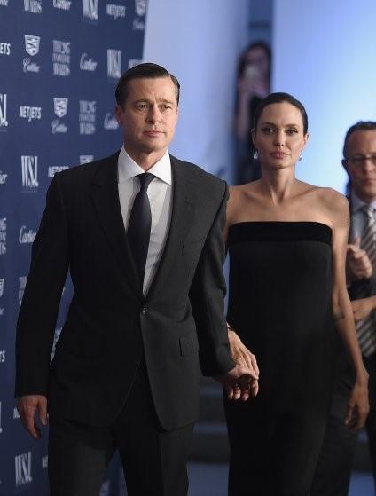 Brad Pitt - Angelina Jolie: Bieu tuong thoi trang Hollywood hinh anh 16