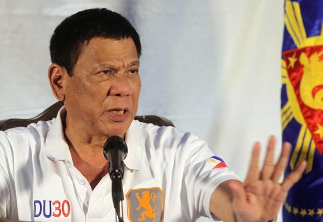 Duterte noi Obama nen 'xuong dia nguc', de doa chia tay My hinh anh 1