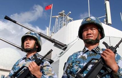 Trung Quốc đang bị cộng đồng quốc tế chỉ trích quân sự hóa khu vực tranh chấp trên biển Đông (Trong ảnh: Lính hải quân Trung Quốc hiện diện trái phép ở Trường Sa). Ảnh: Stringer