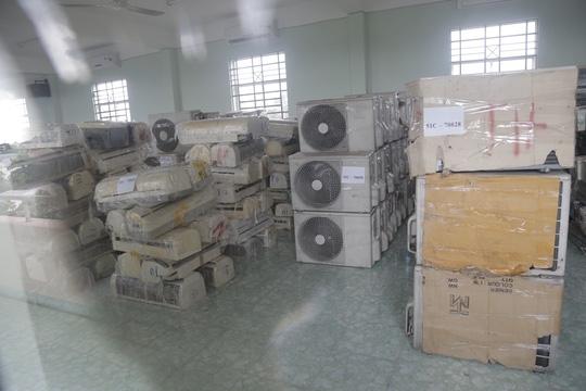 Gom máy lạnh, máy giặt cũ Campuchia về bán cho ta - 1