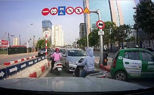 Hình ảnh các xe đi ngược chiều gây ùn tắc giao thông được camera hành trình một ô tô ghi lại.