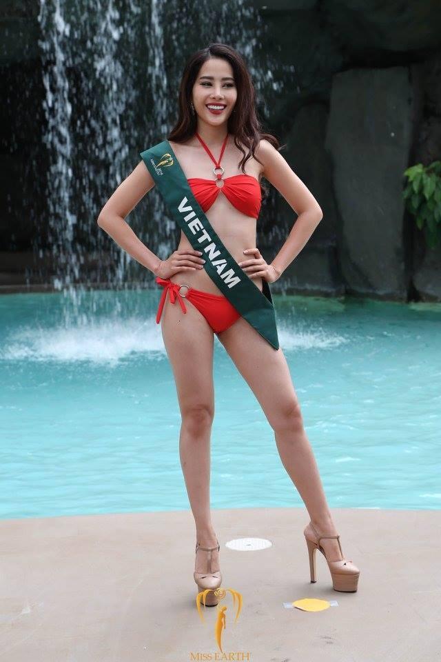 Thí sinh Hoa hậu Trái Đất 2016 chụp ảnh bên băng rôn nhăn nheo, được treo sơ sài như ở hội chợ - Ảnh 3.