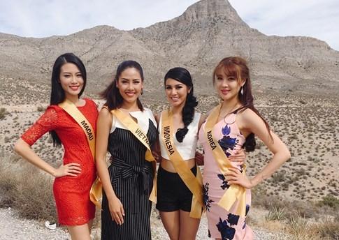 Hoa hậu Venezuala nhón chân để cao hơn Nguyễn Thị Loan - ảnh 1