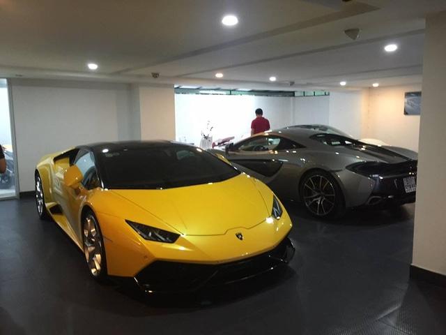 Bộ ba Lamborghini Huracan LP610-4 màu vàng, kế bên là McLaren 570S và trong góc xa là Ferrari 488 GTB.