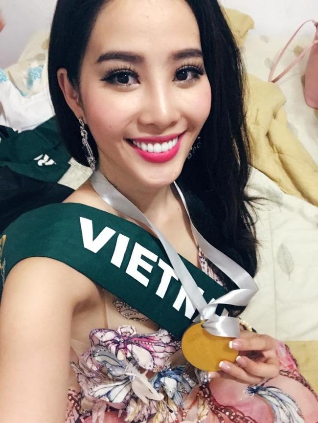 Đại diện Việt Nam - Nam Em đoạt huy chương bạc phần thi tài năng tại Hoa hậu Trái Đất 2016 - Ảnh 1.