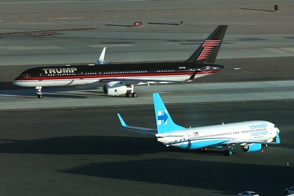 U.S. Republican presidential nominee Donald Trump's campaign plane (rear) passes U.S. Democratic presidential nominee Hillary Clinton's campaign plane as it lands in Las Vegas, Nevada, U.S. October 18, 2016. REUTERS/Lucy Nicholson TPX IMAGES OF THE DAY