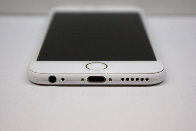 Sau iPhone den nham, xuat hien iPhone trang nham hinh anh 3