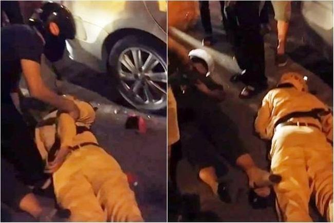 Truy đuổi 2 thanh niên vi phạm giao thông, 2 cảnh sát ngã ra đường bất tỉnh - Ảnh 1.