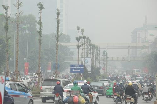 Ảnh: Giữa trưa, Hà Nội vẫn chìm trong sương mù - 8