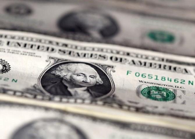 Đồng USD rơi xuống đáy 1 tháng sau họp báo gây thất vọng của ông Trump