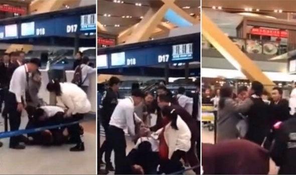 Khách Trung Quốc đánh nhân viên sân bay vì bị hoãn chuyến - Ảnh 1.