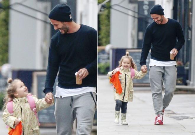 Khoanh khac David Beckham nam tay con gai 'gay bao' mang hinh anh 2