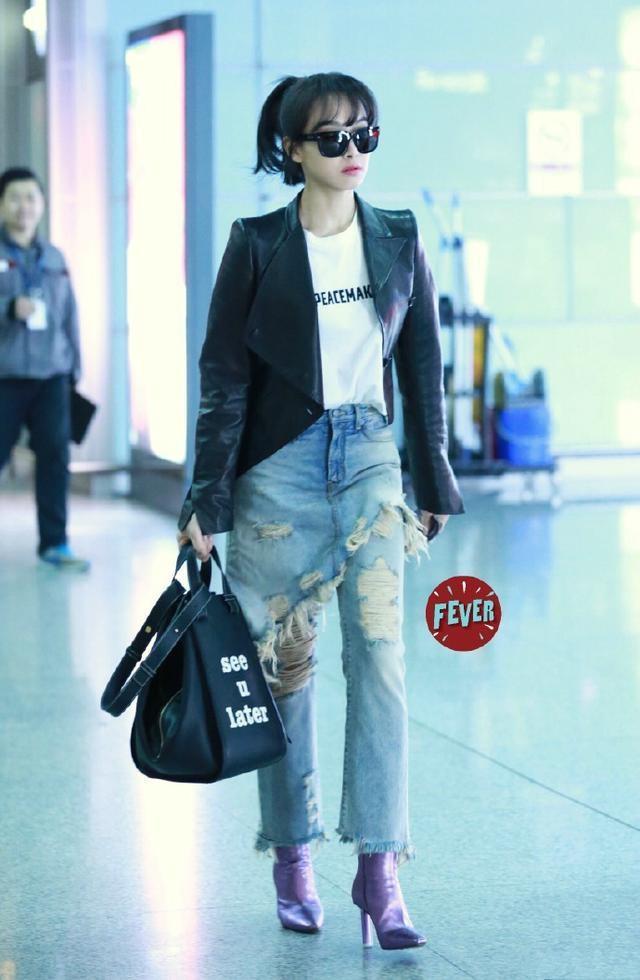 My nhan Hoa ngu dien jeans rach day ca tinh hinh anh 6