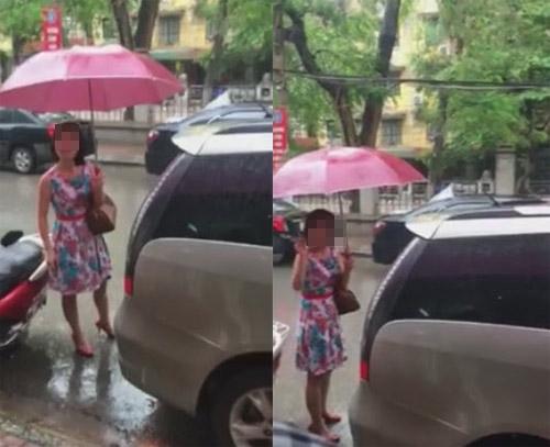"""nguoi phu nu do o to sai truoc cua hang con thach thuc """"nha may co mua duong khong?"""" - 2"""