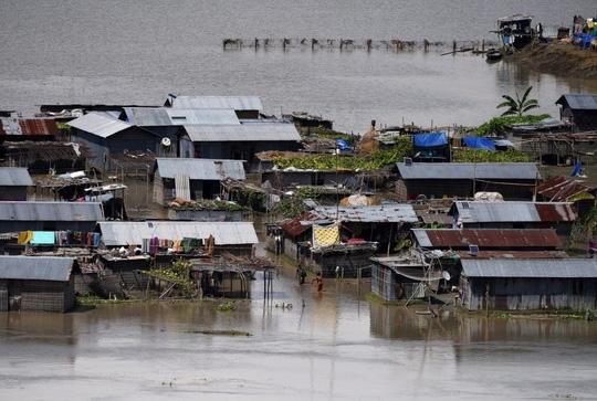 Lũ lụt tàn phá Nam Á, hơn 1.200 người thiệt mạng - Ảnh 6.