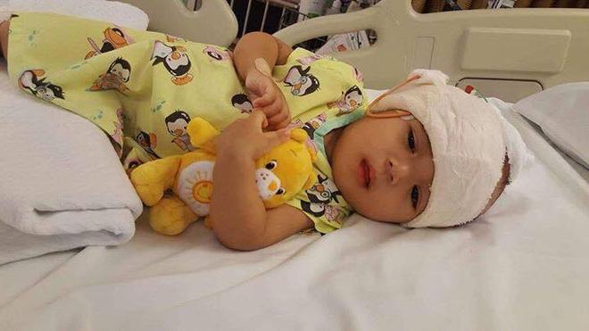Lời kêu cứu của người vợ bị chồng bỏ rơi, con bệnh não úng thuỷ mấy lần chết hụt khi qua Singapore điều trị - Ảnh 4.