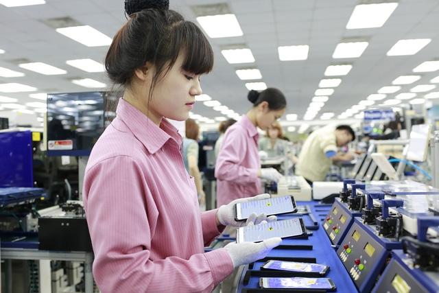 Lao động Việt vẫn gặp khó khăn dù Chính phủ xây dựng cơ chế lương tối thiểu vùng (ảnh minh họa - Nguyễn Tuyền)