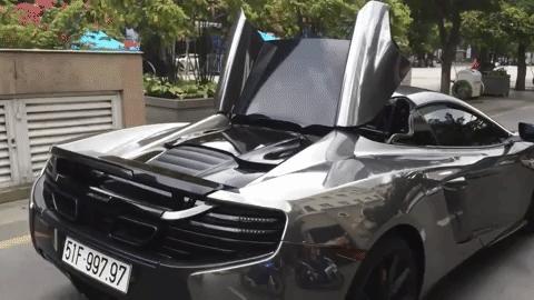 Xem Cường Đô-la đóng và mở mui siêu xe McLaren 650S Spider khi đang chạy - Ảnh 3.