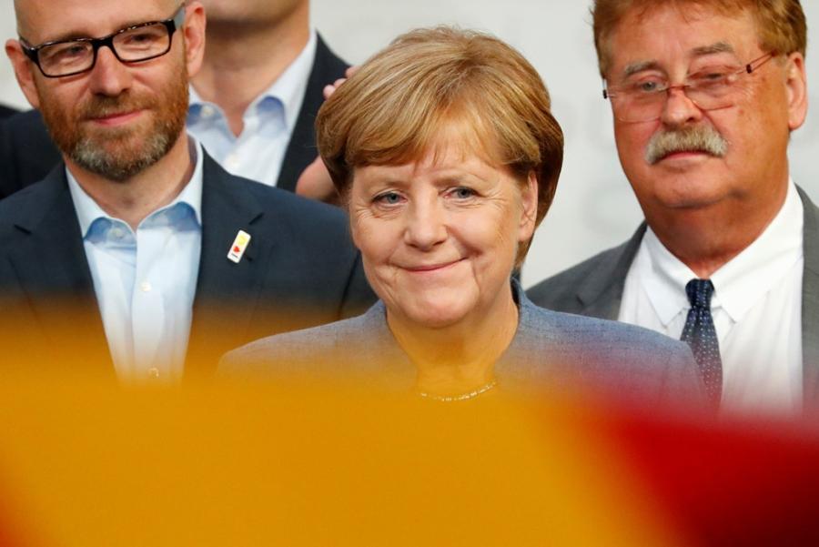 Merkel thang nhiem ky 4: Vi dang tan phat xit hinh anh 1