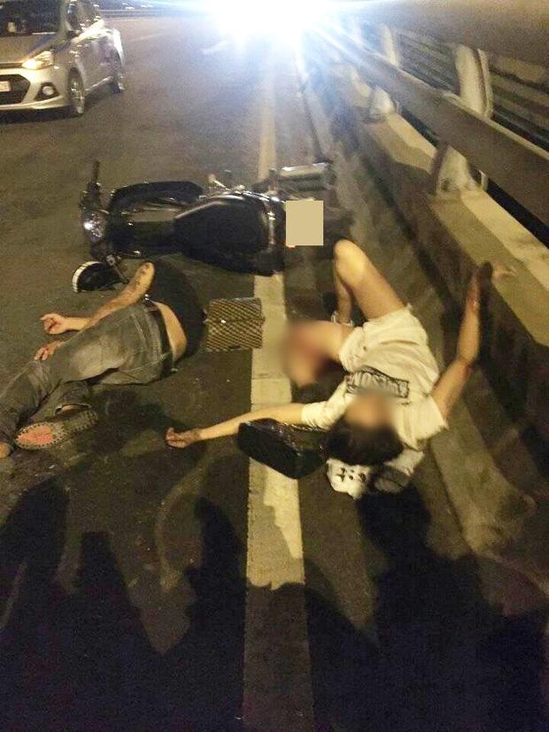 Hà Nội: Cô gái trẻ bị gãy gập chân vẫn bình thản nằm bấm điện thoại sau va chạm giao thông - Ảnh 1.
