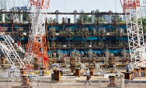Công trường xây dựng sân vận động Olympic ở Gaiemmae, Tokyo. Ảnh: Barcroft.