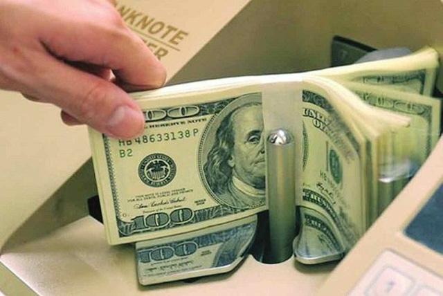 Vì sao Ngân hàng Nhà nước liên tiếp giảm giá mua USD? - Ảnh 1.